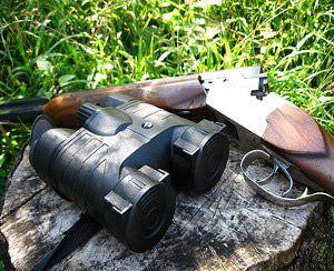 Бінокль і мисливську рушницю