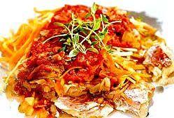 Риба тушкована в томатному соусі.